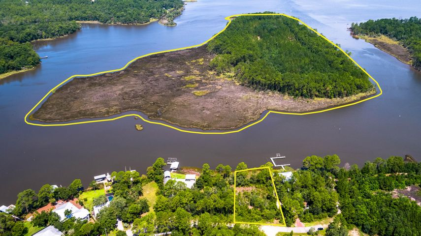 Take a look at the most unique property in South Walton!  This private island is located in the middle of Tucker Bayou, which is at the intersection of Choctawhatchee Bay and the Intracoastal Waterway.  Conveniently located north of Seaside and Seagrove, you can enjoy peace and quiet while being close to all the action 30A has to offer.  The island itself is wooded on the northern half, and contains an Army Corps of Engineers easement. Currently zoned for residential development, this island could be the home of an estate or development unlike anything else in NW Florida.  Packaged for sale with this island is a half acre waterfront lot on Tucker Bayou, and is the perfect spot for a private dock with easy access to the island from your private dock. This island is priced to sell.  At a price less than some gulf front lot sales, the potential return on investment developing this island could be larger than any home built on the beach.  Currently zoned traditional neighborhood residential, the possibility is there for up to 30 units per acre.  A community/resort with nature trails, fishing, boating, sand volleyball, and other recreational activities would be the first of its kind on the Emerald Coast.  There is not another property like this in Northwest Florida.  Survey documents provided for information purposes, buyer to verify all information deemed important.