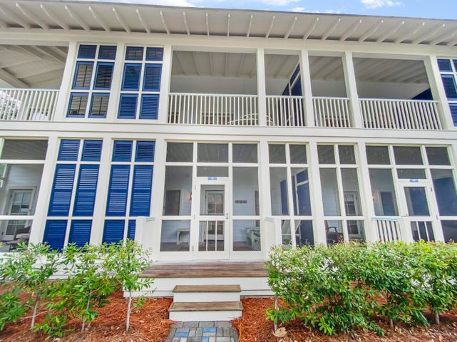 ed porch just touching the treetops of the trees along the WaterColor Boulevard East. Don't miss this condo.