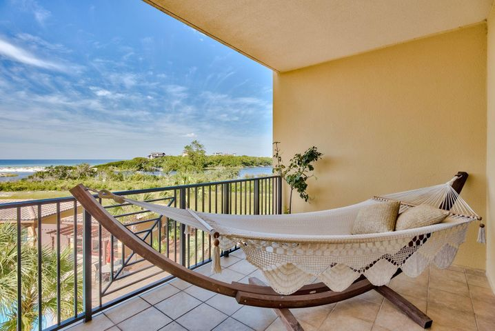 Lazy days can be spent relaxing on the balcony enjoying views over one of three beautifully landscaped pools and the restful sound of a cascading waterfall. Views of the gulf and easy access to the beach and coastal dune lake are a reminder of the prime location of this luxury resort. Shopping, restaurants and golf are just minutes away. Other amenities include over 600 feet of private beach, owners' clubhouse, virtual golf, a media room, private 24-hour security, and ample underground parking.