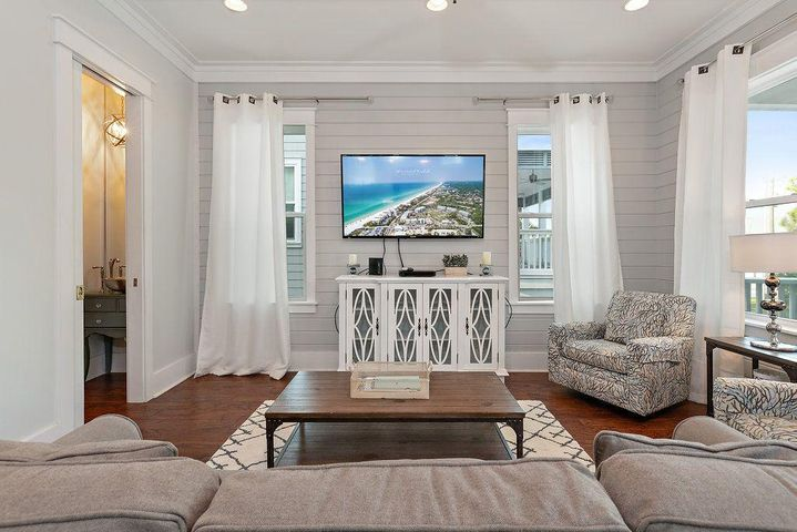 This custom beach home is PERFECTION! JUST 2 SHORT BLOCKS (0.15 MILES) TO THE BEACH WITH A PRIVATE HEATED POOL!!! Enjoy 2 master suites, along with 2 large guest rooms and a game/bunk room in this spacious beach home.  Large kitchen, multiple living areas, and custom extras through out make this home unforgettable. The large game room on the 1st floor offers its own wet bar, full bathroom, and custom bunks.. The first master suite is located just off of the kitchen and main living room and boasts of 1 walk in closet and an extra large bathroom that you will never want to leave. The 3rd floor offers a 2nd master suite with separate seating area that includes a King Bed and a comfortable queen size pull out couch and a large double vanity in the bathroom. Additionally, the 3rd floor also offers 2 guest rooms, each with plush queen beds and their own bathrooms. The kitchen is a MUST see with an extra large custom kitchen island with seating room for 8. All rooms have high definition flat screen TV's and full cable packages. All plush comfortable mattresses are adorned with the softest high quality sheets.  This home also has an elevator for ease and convenience when moving in luggage!