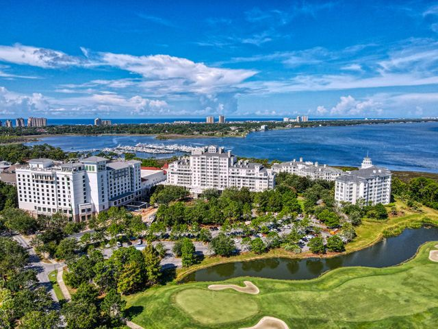 """*Now AVAILABLE* COME SEE IT TODAY. GROSS INCOME for 2019 $47,600 this 3BR/3BA condominium residence has tile floors throughout, granite counters, stainless appliances, large balcony from the living room to enjoy peaceful resort views of lush green golf courses, well maintained grounds and the bay. The condo offers split floor plan with spacious living room, two Master bedrooms with large baths with jetted tubs and separate showers. Enjoy the view from your living room, kitchen & all 3 bedrooms  Perfect escape for you and your family and a great Rental property. The Grand Sandestin offers luxurious amenities including elegant Lobby with Ballyhoo Bar & Lounge, full concierge service, fitness center, swimming pool and valet parking for your convenience. Perfectly located at a walking distance to Baytown Wharf village offering variety of restaurants, shops nightlife entertainment, Sandestin Marina. Short Golf Cart/Car ride will bring you to the most famous white sand beaches of Walton County or the newly developed """"Grand Boulevard"""" offering one of a kind boutique shops, dining experiences and modern Movie Theater to enjoy with friends & family or business partners. Sandestin Resort offers an abundance of Amenities to enjoy. Four Golf Courses (Links, Baytowne, Raven, Burnt Pine) Bike Rides, Kayaks, Wave-runners, Tennis Courts, Putt-putt course and more..."""