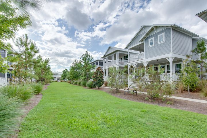 This Wind Song plan has it all open concept living and a beautiful master suite on the first floor. This is our brightest floor plan with lots of natural light. Kitchen includes built in GE Caf Appliances with refrigerator, Shrock quality cabinets, granite countertops and tile backsplash. Baths are all light and bright finishes. Wood floors throughout the whole house, outdoor showers, impact resistant windows/ doors, and 2 x 6 exterior framing are just a few of the things Kolter does differently than other area builders. NatureWalk at Seagrove has become the premier place to be near Seaside with the amenity-rich Gathering Place- complete with heated lap pool, hot tub, zero entry pool, fire pit and more!