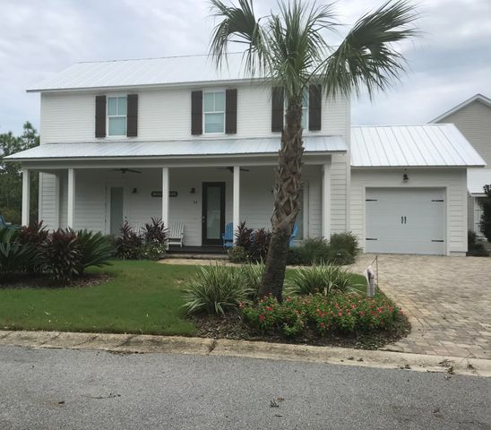 Beautifully designed and exceptionally built with 6'' outside walls w/foam insulation...this beach home is perfect for the family. Community pool is right down the street and a nice regional beach access is right past the ice cream shop!  There is an awesome suite with a full bath and 1/2 bath for guests on the first floor. The second floor has the main suite/en suite, and two guest suites  (one set up as bunk room) and a guest bath.  Large porch to enjoy cool afternoon sweet tea and nice gathering spot on the back patio. Superb location on a quiet cut-de-sac. First floor has 10' ceilings and open floor plan. *All information including lot dimensions to be verified by buyer*