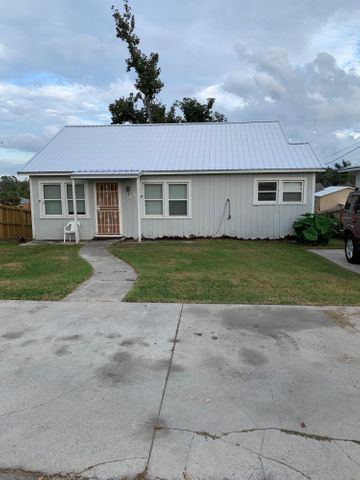 Are you ready to take this house in the Cove and make it your own?  This fixer upper features 2 bedrooms and 2 baths with a basement below and a deck in the back.  The property can also be accessed from the back alley access.  It convenient to Downtown, Panama City Beach, and Tyndall Air Force Base.  Don't miss this opportunity!