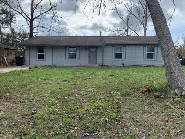 Nicely remodeled block style 4 bedroom/2 bath home with access to lake in the backyard. New floors, drywall and paint. House sits on .28 acres.