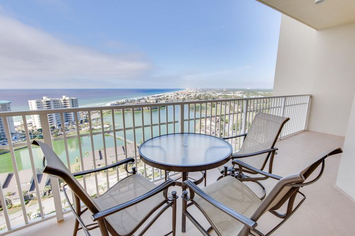 ENJOY UNBELIEVABLE PANORAMIC VIEWS of the gulf & coastline from the large balcony! You will want to stay & experience the coastal lifestyle this condo can offer! This 19th floor end-unit is in Building II of Ariel Dunes is located in the premier gated beach & golf community of Seascape Resort. The condo features an open floor plan & has not been rented since the present owners bought it - it is in immaculate condition.  The fully-furnished & accessorized condo has a separate bath adjoining each of the three bedrooms. HVAC is two years old & hardwood floors were installed two years ago.  There is also a laundry closet with a full-size washer & dryer & exterior storage room.  The views of the gulf & bay from the two separate balconies are spectacular. Other amenities at Ariel Dunes include: 2000 feet of deeded white sand beach, three large pools, the Cabana Cafe, golf, tennis, fitness room, & a conference center. Conveniently located to shopping, restaurants, & everything you could want or need in Miramar Beach halfway between Destin & 30A - this one is a must to see!! Make it the top choice on your list!! All information deemed reliable but not guaranteed.