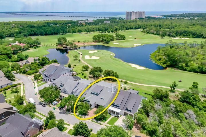 PRICE IMPROVEMENT !! Desired Kelly Plantation Smart home  enjoys a beautiful site on the golf course. Inside, the 12' first-floor ceilings, abundant natural light, neutral colors, and quality finishes provide a great backdrop to showcase your lifestyle. Originally constructed in 2014, many upgrades were added in 2017, including incredible voice- and motion-activated technology that allows you to control the security, lighting, blinds, audio, video, and more without lifting a finger!From the impressive brick entryway, the floorplan flows through a spacious foyer, past the double glass doors of the office (or second master bedroom) to a uniquely angled formal living and/or dining space, and then into a large living/family room with gas fireplace and open kitchen. The kitchen features gorgeous quartzite countertops, luxurious black cabinets, a stainless sink, and new stainless appliances, including a Wolf gas cooktop with electric oven, large Subzero, and much more! The home is oriented toward the sweeping vista of the 18th fairway of the Fred Couples Signature Golf Course--enjoy the relaxing and inspiring view of the soothing greens and blues including a lake and surrounding pine trees. A large theater room graces the upstairs, which also includes 2 bedroom suites, a lovely deck overlooking the golf course, and abundant storage. The home offers a wealth of great conveniences, including a steam shower in the master bath, spacious utility/mud room, 3-car (stacked) garage, and a lovely summer kitchen out back. Just steps down the street lies the Kelly Plantation Clubhouse with its large pool. Tennis, golf, horseback riding, and the other great amenities of Kelly Plantation are also close at hand!