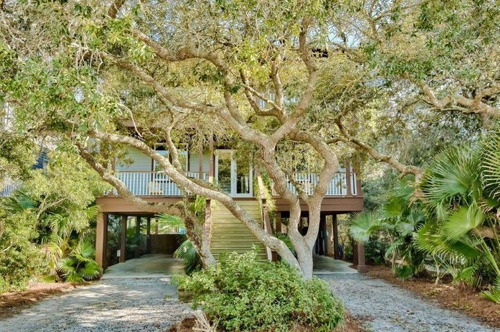 ''Absolutely Grayton'' is a 5 BR/4.5 BA classic Beach House nestled in a canopy of oaks in one of 30A's most charming and sought after historic coastal villages. This is the perfect primary residence or 2nd home vacation destination that generates solid rental income. Short stroll to the undisputed/public white, sandy beaches, Western Lake-area's premier coastal dune lake sanctuary and iconic eateries such as Red Bar, Chiringo, A.J.'s and Borago. Thoughtful design incorporates the beauty of nature with plenty of outdoor space for entertaining, including open and screened porches overlooking a large private pool and sun deck in sizable, fenced rear yard. Covered parking/patio area under house also allows for perfect recreation/play space when not on the Beach or Western Lake. Custom  interior features 10' ceilings, hardwood flooring, recessed lighting, crown molding, custom cabinets & tile throughout. Sold furnished except for artwork and some personal items that may be negotiable. $85,259 gross rents on books so far in 2020 as of date of listing, including some owner use and several weeks missed early Spring due to Covid.