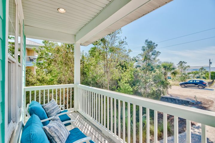 Featuring 4 bedroom and  4.5 baths this beach house is the perfect family getaway and an excellent vacation rental. Less than 1,000 feet to the beach.  Enjoy a fully furnished, well appointed open floor plan.  There is a  first floor master, hardwood floors throughout, stainless appliances, large kitchen island, full size washer and dryer, and great porches. In addition to the 4 bedrooms, enjoy a bonus 2nd story living area for hanging out and extra sleeping. Covered parking underneath the home as well as large driveway for parking. Extra space below  has a seating area, grills and outdoor shower.  It's a quick walk or golf cart drive to the beach. (Golf cart conveys).  You really can walk to the beach from this house! This is a perfect hideaway on the quiet side of 30