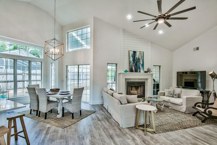 Spacious open concept with plenty of entertaining space. Raised ceilings extend to nearly 16 feet at the peak!