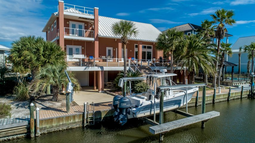 80' Canal-front Mediterranean-style home on Navarre Beach on the intracoastal waterway!