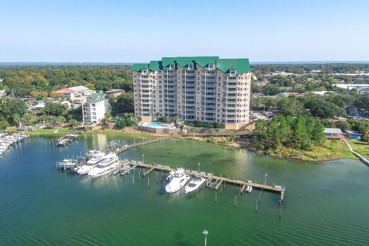 Enjoy Stunning Gulf and Harbor Views from this Amazing and Recently Renovated Condo. Look to the South and you will see the Harbor, Holiday Isle, and the beautiful turquoise waters of the Gulf of Mexico. To the West, sensational sunsets, luxury yachts and fishing boats can be seen coming in and out of the Harbor. There is a super sized 70' x 22' Boat Slip that can be purchased separately. Experience luxury living in this beautiful 4 bedroom condo at Grand Harbor. This fabulous condo is sold completely furnished and move in ready. Singular attention was paid to every detail including the state of the art, whole home, audio/video system that was installed at a cost of more than $40,000. Call to schedule your private viewing today.