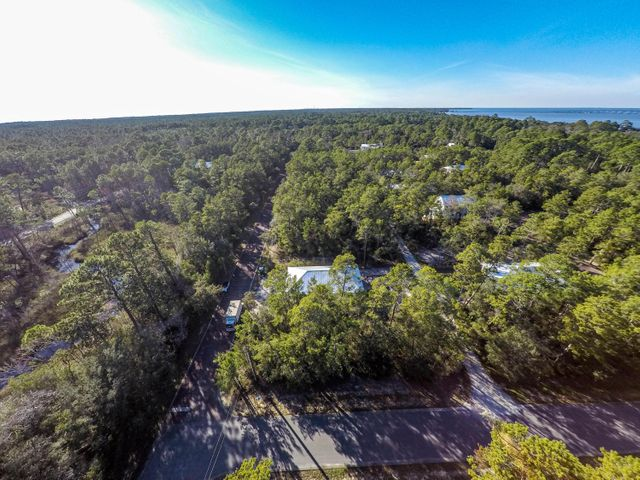 **Construction begins 01/15/2021 **Grayton Bayou is the hidden gem along the Emerald Coast!  Located just a block from the Choctawhatchee Bay this to-be-built gorgeous craftsman 3 bedroom, 3 bathroom  plus office home is not going to last long. This one-story beauty has a thoughtful design with many notable features including 10'' ceilings, two covered porches, shiplap, shaker style cabinets, huge pantry, giant kitchen island with quartz countertops, stainless appliances, tile flooring in the baths and luxury vinyl throughout. The master suite has a humongous tile walk-in master shower with plenty of relaxing room plus bench seat. The exterior of the home features a one-car garage, sprinkler system and gravel driveway. Community pool and walking distance to public bayside park.