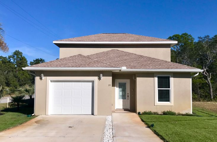 Low maintenance stucco and easy care landscaping