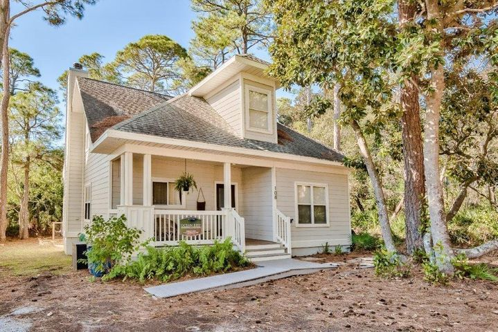 Classic Grayton Beach Cottage 'Tuckaway' with all of the modern conveniences nestled among the oaks and magnolias on coveted  Magnolia Street.  This timeless design features 3 BR, 3 BA, 2 bonus rooms, and a balcony/deck off 2nd floor bonus room. Covered front porch, popular open kitchen / living / dining floor plan with fireplace and 9' ceilings throughout. Rear screened-in porch overlooks a fenced back yard that provides room for expansion and a pool. Ground floor Master BR boasts walk-in closet. Short stroll to 2 beach accesses to state owned,  uncontested, world-famous Grayton Beach and Grayton State Dunes. . Easy walk to famous eateries such as Red Bar, AJ's, Chiringo, Borago, Grayton Brew Pub. New to rental market, but much potential. Kayak, SUP on Western Lake. Bike 30-A and beyond!