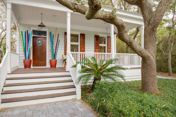 This Old Grayton Beach Cottage was built for and the construction was supervised by, the grandson of one of the founding fathers of Grayton Beach. At the time of construction, the owner was a charter boat captain, thus the nautical theme. The house was designed by an architect in Seaside to be respectful of and complementary to the cottage style in Grayton Beach.  The style of the house is: modified shotgun.The front door is solid mahogany hung on 200-year-old solid brass bayonet hinges. The Cypress boards used for the trim, mantel, wainscoting and cabinets in the living room/kitchen were hand selected at the sawmill by the owner, then planed to order. Notice very few knots.  The Cypress dining room table was custom built for that space. The fire place was hand built, is wood burning, draws perfectly and throws an impressive amount of heat.  A nice treat after those winter days on the beach!  Behind the fireplace is a chart desk from a World War II Liberty Ship (Destroyer).  The thin drawers held the charts and the glassed-in case contained the compass and sextant used for Navigation.   This will stay with the house if the buyers would like it.  The kitchen includes a professional natural gas range with a commercial stainless-steel vent hood which is vented to the outside. A free-standing icemaker, refrigerator, dishwasher, microwave, disposal and a natural gas tankless water heater (Rinnai) is also provided.  Operable hurricane shutters affixed to all of the windows.  The carriage house was added at a later date and the living quarters have been recently updated. It is run on it's own power grid and can be powered by a generator if the need arises.  The range is propane.  A Murphy bed and fold out sofa allow sleeping for 4.  The lower level includes a tool room and an enclosed 2 car garage, a rarity in Grayton Beach.  You will never run out of storage space.  The pavers from the front parking pad back to the carriage house were recently added.  The screened in porc