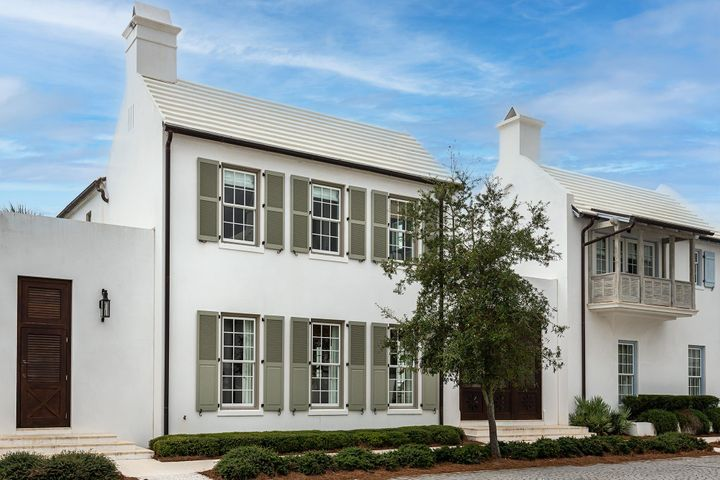 Alys Beach home designed by Gary Justiss, Architect.  This home is located north of 30A and within a short walk to ZUMA and Caliza Poll & Restaurant.  This home offers 2 Master Suites, Living Room with Fireplace, generous Courtyard with private pool, and 2 car garage.