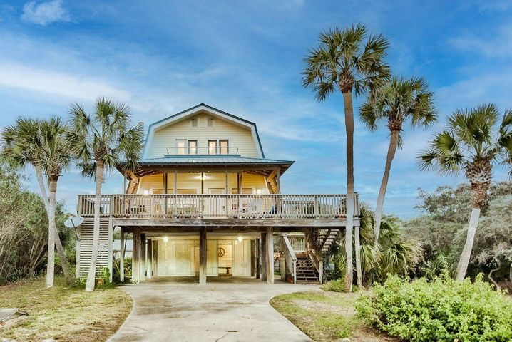 This highly coveted second-tier location in Old Blue Mountain Beach nestles a charming vintage beach cottage boasting heart pine floors and a cozy fireplace.  A generous quarter acre homesite offers future build-out potential as well as up to Walton County's height restriction of 50'.  Some renovation on bathrooms has been completed.  Great Gulf views across road.  Beach access is three lots over to either side. Old Blue Mountain neighborhood owners have BEACH USE rights, not just beach access, a rare amenity in neighborhoods along 30A!   Also, there is a mechanical lift from the carport to the second floor!  Stroll to restaurants, cafes, bakery & grocery or jump on your bike and hit the bike path.