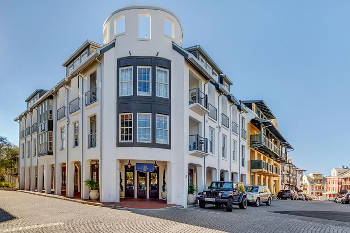 LOCATED IN THE HEART OF ROSEMARY BEACH ON THE GULF SIDE, this spacious Penthouse unit features Viking appliances, hardwood floors, granite countertops, slate tiles, Kohler plumbing fixtures and mahogany doors. The four Bedrooms enjoy en suite baths and 3 of the 4 are adjacent to a private balcony.  French doors open to the walled, oval Belvedere creating an outdoor room with access from the Dining and Living areas.  The perfect place to enjoy views of Rosemary Beach, the gulf and beyond. In addition, this unit has a garage and second parking space.  A wonderful amenity in Town Center!