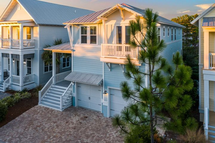 This turn-key, beautifully decorated, very well maintained beach house is perfect for a rental or second home. The open floor plan and sophisticated beach decor make it the ideal spot to relax and enjoy all that 30A has to offer. Located on a premium lot with a pond view and just steps from the incredible resort-style community pool. The first floor provides a very open floor plan with ample room for entertaining, dining, and unwinding from a day at the beach. There is also a screened in porch to enjoy the cool nights. Upstairs you will find a spacious master suite and three guest bedrooms. The master bedroom also has a private screened in porch. The oversized garage is the perfect place for your vehicle, golf cart, beach gear or all of the above.