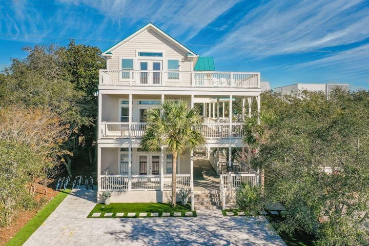 Fantastic Opportunity in the heart of Grayton beach within a 1 minute walk to the newly reopened Red Bar and 2 minute walk to the beautiful white sand beaches and Gulf. This popular rental retreat offers everything needed for large family gatherings including a large newly updated pool and sunning deck and huge bunk room w/ 4 built-in full size & 4 twin bunks and TV/gaming area for the kids! Each bedroom offers en-suite bathrooms and private balconies giving all guests private getaways. Grab a glass of wine and watch the sunset with amazing views of the Gulf and Western Lake from the third floor balcony.The home is well-equipped for the crew with a Chef's kitchen including Thermador gas range, two Thermador dishwashers, and two side by side refrigerators and a separate ice maker. ice maker.  Two sets of commercial washers and dryers and two tankless water heaters with unlimited hot water for those long showers after beach time. Huge paver guest parking out front with room for up to 10 vehicles. For those who like to paddle, Western Lake, 30A's largest coastal dune lake is just one block over, or just a short stroll to beach access at end of the road. This location offers something for everyone. Bike to shops along 30A or venture to WaterColor and Seaside for concerts and people watching. This is a very popular rental home for family reunions, weddings, and business retreats and sleeps 23.
