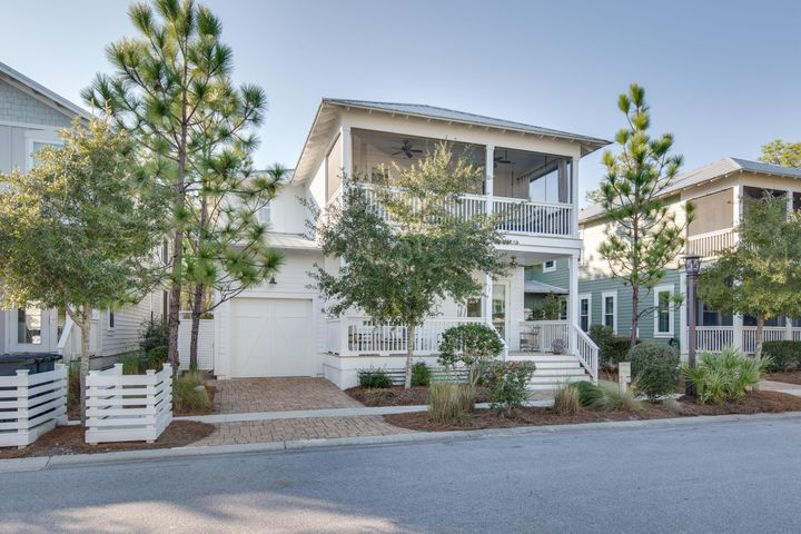 UNDER CONTRACT BUT ACCEPTING BACK UPS.  77 Beargrass is the quintessential Seaside beach house with sweet farm-house touches throughout!   Located on a quiet dead-end street and towards the front of the community this home is in the perfect location to relax or bike to the beach! As soon as you walk in the front door you will notice that this home is unlike other homes in NatureWalk. It has been fully upgraded with custom touches not seen in any other home AND comes furnished!  White washed, solid pine floors & extensive Vgroove throughout. Through the double front door you are welcomed into a spacious foyer with dining room off to one side. This beautiful space is showcased with beamed ceilings & ship lap walls. The kitchen is open to the living room and dining nook and offers plenty of space to entertain.  Bar area includes an ice machine for evening cocktails and kitchen has been decked out with all the extras. This is the only home in NatureWalk with Calcatta Gold countertops with the prettiest decorative edge.  Cozy living room features wood beams to compliment floors, fireplace with painted white brick and marble.  This all opens up to private, screened in porch and paver terrace area to enjoy the tranquility of Point Washington State Forest. This is THE place to be at sunset where you can see cotton candy skies and hear birds chirping in the forest. Also on the first floor is one of THREE owner's suites. Being positioned on the back of the house, from bed you can take in the forest views too! En suite bath is fully done in marble also and included a jetted soaking tub, large walk in closet and vanity area! Upstairs you will find a loft/ 4th bedroom area that would be perfect for bunks or a tv/ playroom area for the kiddos. This could easily be closed in and a barn door installed.  The back bedroom is huge with plenty of room for King Bed and a separate living area (or even another bed) and also has a screened porch with cozy porch bed to overlook nature! The front bedroom also has access to a big screened in porch with a cozy porch bed! CDD Bond is paid off- saving you $$$ on your yearly tax bill. Not many homes in the community have this paid off.  NatureWalk at Seagrove has become the premier place to be close to all the fun in Seaside and the white powder beaches of 30A. Getting to the beach is easy with short cut trail through the forest- just a 5 min bike ride to Seagrove beaches. The Gathering Place, the neighborhood amenity center is complete with heated lap pool, zero entry pool, hot tub firepit, grills and more. The community also has trails throughout, Energi fitness station, fishing and a multi-purpose court.
