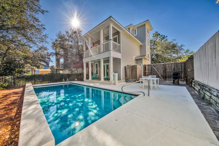 UNDER CONTRACT BUT ACCEPTING BACK UP OFFERS. An idyllic retreat in Seagrove Beach, south of 30a and steps from the famous sugar sands of the Emerald Coast, this lovely beach cottage boasts 3 spacious bedrooms plus a loft/potential bunk room. With a sought after open floor plan and charming touches throughout, this home is sure to please. The backyard which abuts dedicated green space will be your favorite place to unwind in the oversized 12x 30 pool after a long day at the beach. Tucked off the beaten path this darling home is surrounded by mature trees providing privacy to enjoy the many porches and patios. A separate storage shed is the perfect place to store bikes and paddleboards and an outdoor shower with hot and cold water complete the outdoor amenities.