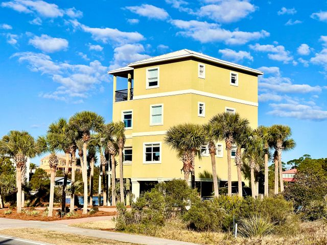 Its all about the location and view. Located on 30A directly across the street from the beach and on a coastal lake provides the best of both worlds. One either has a lake or Gulf view from every room in this house. The current owner has made many upgrades since owning the home and it is ready for its next owner. An abundance of natural light enhances an open floor plan providing great living space. Located in the desirable and up and coming Dune Allen Beach with the infamous Stinky's restaurant just a few steps from the home. This will make a fantastic rental vacation home due to its location and sleeping capacity.