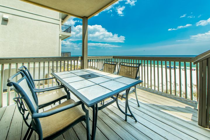Rental Calendar is filled for the 2021 year. This carefully prepared townhome is just a few steps on to the white sands of the Emerald Coast. This three bedroom, three and a half bath townhouse provides balcony access on all three floors and sleeps 10 comfortably. The first floor boasts a Sapele wood, tropical hardwood bunk bed, two bedrooms, and a living area. The second level consists of the kitchen with an open bar that allows the chef to view the main living area and the beach while entertaining. The third level finds the master suite with unparalleled views of the Gulf, as well as a queen bedroom. The plantation shutters are specially made of sinker Heart Pine, prized for its beauty and durability. Crown molding throughout, artwork included, and no HOA. Photos do not show custom beautiful plantation shutters, or new bookcase built-ins located in the den. Kitchen counter and bookcases made from sustainable, tropical African mahogany.