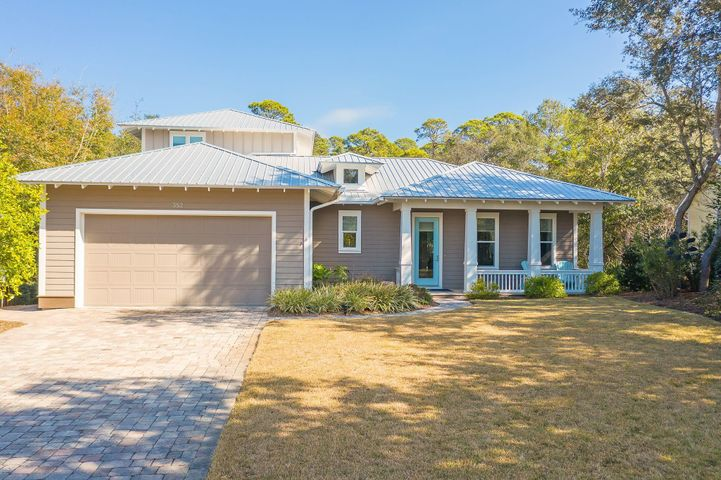 This 4 bedroom 3.5 half bath home built in 2015 with 3,339 total square footage is located in the nonrental 30A neighborhood of Seabreeze on over a half-acre private lot with mature oak, magnolia and palm trees and backs to a creek. The grounds are meticulously landscaped and include a well/pump and irrigation. The property has a paver driveway, walkway and patio, and a large lanai with a pool plus has an oversized two car garage. There is also a large storage area underneath the home, so there is plenty of storage space for bikes, kayaks, paddleboards, beach chairs, etc.  The home has a 22KW whole house generator that is under warranty until 2028. This is an energy efficient home with spray foam R-13 insulation in the outside walls, spray foam R-14 insulation in the subfloor and spray foam R-20 insulation in the roof , two 14 Seer heat pumps and a tankless hot water heater. The average electric, gas and water bill is $200/month.  The home offers 10 foot ceilings, 7 ½ inch trim, crown molding, recessed lighting, ceiling fans and antique Java bamboo flooring.  This bamboo flooring is the world's hardest floor and each plank is meticulously hand scraped for a naturally aged look and feel and has a 50 year residential warranty with a 10-coat scratch resistant finish. The home has a light and bright open floor plan with ample windows allowing you to overlook the beautiful screened lanai and pool area. The large lanai offers additional outdoor living space, al fresco dining and is a grillers paradise allowing you to enjoy the natural serene surroundings and open-air living at its best! The living room has both a gas fireplace and floating shelving. The kitchen offers stainless steel appliances to include a LG refrigerator, LG dishwasher, GE microwave and double gas oven, blanco sink, lighting under the cabinetry, a large center island with a prep sink, trash bin drawer and a large pantry with wooden shelving.  The kitchen opens into the dining area and both overlook the 