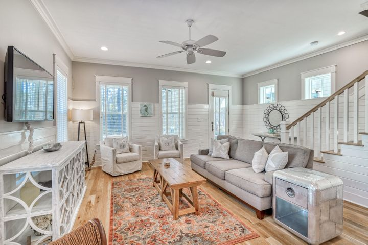 This Watercolor cottage is everything you've been looking for! Built by Huff Homes in 2014, this 5 bedroom, 4.5 bath home has everything you need for a primary or vacation home, fully furnished (including a golf cart), this home features; wire brushed oak hardwood floors throughout, V-Groove wood walls, wine cooler, 10' ceilings, an open concept living area, and a spacious screened in porch. The first floor is completed by one of two master suites. Upstairs you will find a second living area with vaulted ceilings, the primary master suite overlooking WaterColors lush natural vegetation, two guest bedrooms; one with its own ensuite bath, and an oversized bunkroom, perfect for a kids.  Rentals: 2019 $42,663 & 2020 (due to Covid) $38,023.