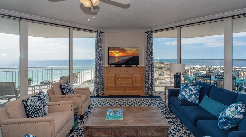 Live and play where extraordinary views surround you. 1304 Belle Mer on Navarre Beach majestically rises high above the most beautiful beaches in the world. This coveted, west-end corner 4 bedroom 4 bath luxury condominium home is masterfully designed for the beach lover. The spacious waterfront living/dining rooms and four en suite waterfront bedrooms let on to balconies with sweeping views. This beautifully decorated condominium home with open floor plan recently received over $50,000 in desirable interior appointments and upgrades. Breathtaking daily sunsets beckon you to the wrap around balcony, which expands the living space creating an outdoor haven perfect for entertaining--complete with endless views. The azure waters of the Gulf of Mexico, miles of white sandy beaches and the sparkling Intracoastal Waterway of the Santa Rosa Sound unfold before your eyes creating an awe inspiring sense of wonder. Marvel at the sea life and delight at seeing the wind catch the sails of watercraft leisurely sailing on the sound. It is all here and waiting for you to kick off your flip flops and relax. This welcoming residence delights with new furnishings in the Great Room, Master Bedroom and Foyer, along with fresh paint including the cabinetry, along with new lamps, art and accessories and new window treatments throughout. The fabulous kitchen with stainless appliances marries the dining and living room for ease of entertaining, received a new look with painted cabinets, Quartzite countertops, ceramic backsplash, new sink/faucet and dishwasher. All the baths feature gorgeous Quartzite counters and dressing area complimented by new lighting, mirrors, sinks and faucets with raised, painted cabinets for a fresh clean look. We invite you to discover Belle Mer with only 62 three and four bedroom gulf front residences, over 200 feet of beach, a gulf front hot tub and pool, tennis and basketball, meeting room with kitchen, a gym, plus the association owns the lot to the west contiguous to Belle Mer. Make your appointment today to preview Navarre Beach's premier gulf front condominium with million dollar panoramic views. You will experience a stunning Gulf front residence with impressive rental history.