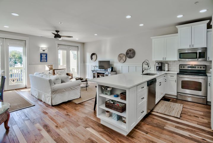 Bright and Spacious condo in the heart of Seagrove located just across 30A from the beach in the mixed use development of Grand Isle!  Private community pool and gated, deeded beach access!   One bedroom and two full baths comfortably sleeps four. Recently upgraded in 2019 with Walnut engineered wood floors throughout, new white shaker kitchen cabinets, quartz countertops, additional owner storage under the kitchen peninsula and custom locker in master closet, and board and batten wainscoting. Also new HVAC, stackable washer/dryer and water heater!  LOW HOA FEES $305/month. A small complex lends itself to a true neighborhood feel with friendly owners. Bike to Seaside or walk to several local restaurants such as The Perfect Pig, Old Florida Fish House, Angelina's, Donut Hut, and Cafe 30A. Beach chair service also available. Owners pets are allowed.