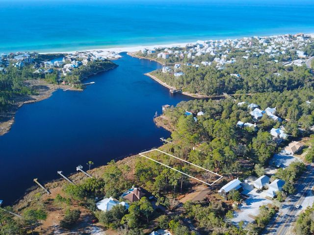 This 0.6 acre lakefront homesite is located south of 30A, in Blue Mountain Beach on Draper Lake. This incredible lot can be found within the private gated community of Crescent Caye. Enjoy 82 feet of lake frontage on a rare coastal dune lake with stunning lake and Gulf views. A dock is permittable, so you can kayak, paddleboard, or have a small motorized boat to get to the beach easily. Crescent Caye is a private neighborhood yet conveniently located near Gulf Place, Grayton Beach, WaterColor, and Seaside.