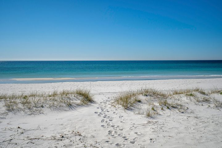 "AMAZING .32 ACRE GULF WATERFRONT LOT WITH 110 FEET OF GULF FRONTAGE! This is an Excellent Opportunity to Own a Slice of Paradise on the Gulf of Mexico and Build to Suit your Dream Home and Beach  Retreat. Gulf Front Lots and Navarre Beach Land to Build on is Becoming a Rarity and Demand is High to be in Florida's Most Relaxing Place. This is an Excellent Location to Be on the Beach, Located just a Short Distance to the Shops, Nightlife, Restaurants, Pier, and Parks, and Convenient for On and Off the Island with Proximity to the Bridge. Don't Miss this Fantastic Lot Located on Navarre Beach with Miles and Miles of White Sandy, Crowd Free Beaches and Stunning Emerald Hued Waters. There's plenty of Leisure Activities to enjoy whether on the Gulf of Mexico or the Santa Rosa Sound, with Parks, Hiking/Biking Paths, and the Spectacular Gulf Islands National Seashore. Just over the National Seashore is Pensacola Beach for even more Entertainment, Shops and Restaurants. Come See Why Navarre Beach Has Been Coined ""Florida's Most Relaxing Place."""
