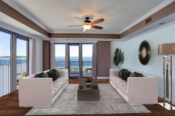 Live the coastal lifestyle in The World's Luckiest Fishing Village! Located at the foot of the Destin Bridge this luxurious corner unit is in a superb location of West Destin where you will enjoy panoramic views of the Harbor, East Pass, Bay, Gulf of Mexico and Crab Island in private gated community with largest wrap around balcony in the complex. Balcony offers 1344 sq ft of unbelievable views and access! Custom interior features include 10 ft vaulted ceiling, ceiling fans, tile + hardwood floors, crown molding, and granite counters. Hardwood floors in bedrooms, 3 full baths and bonus room connecting master to guest bedroom can be used for office space or additional sitting room w/amazing views. Community amenities include gated entry, pool, exercise room, community room, covered parking, BBQ grills, gazebo, kayak/paddle board storage. Private owners can acquire boat slips if available after purchase of condo. You'll enjoy watching boats passing by as the Destin fishing fleet comes in and out of the harbor, playful dolphins in the bay + majestic pelicans flying by sunrise, sunset and all throughout the day in a quiet, private community. Located just steps from Harborwalk Village, McGuires, Dewy Destin's, shopping, dining, fishing and entertainment.