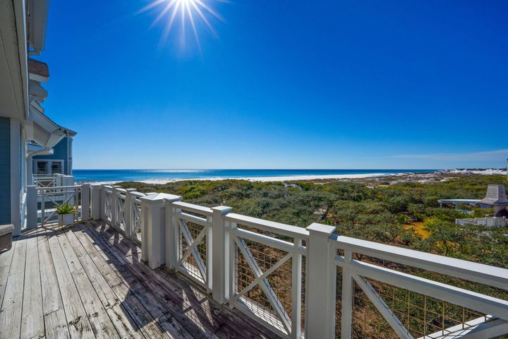 Located within the gated community of Watersound Beach, experience premium gulf-front living with this third floor single story Watersound Crossings unit. Enjoy low density living paired with spectacular views of undisturbed coastal dunes and endless sparkling gulf waters. The open living, dining and kitchen areas highlight an abundance of natural light and present the perfect layout for entertaining guests. Located off of the living area, the expansive porch offers a great space to enjoy the spectacular Gulf of Mexico seascape. The master suite features a sitting area, ensuite with double vanity, walk-in shower and jetted tub, and large walk -in closets. Ensuring guests privacy, there are two additional guest suites located on the other side of the living room. A powder bath, click more.. large laundry area, and owners closet complete the unit. Other notable features include hardwood flooring, stainless steel appliances, custom cabinetry, expansive windows, tile, and deeded single car garage. Recent updates include washer and dryer, dishwasher, HVAC, dehumidifier, mirror and lights in master bath, and hot water heater.  Inspired by the architectural style of coastal New England, Watersound Beach is a gated community situated on over 1400 acres, with 90 acres of coastal dunes and over a mile of private coastline. Amenities include: community pools, fitness center, puttering park, community green spaces, various parks, trails, and miles of pedestrian paths and boardwalks leading to the beach.