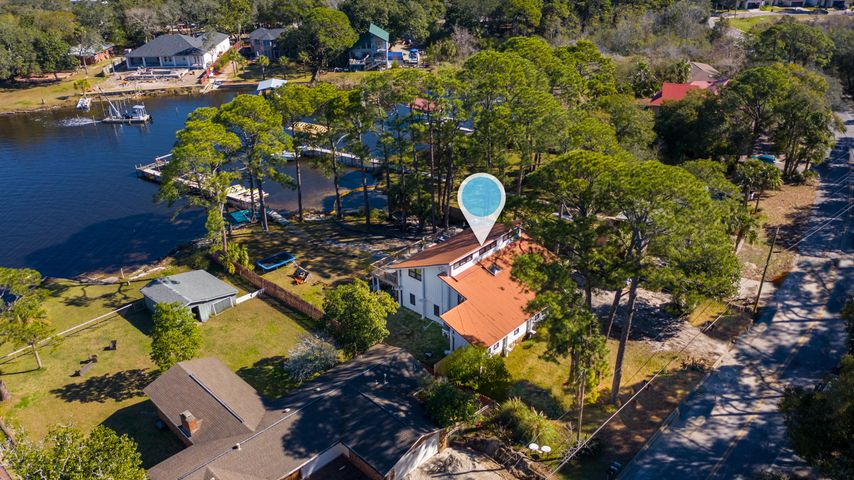You do not want to miss this beautiful gem in the heart of Destin!! Located just steps away from the world famous Harbor Walk Village. This is your chance to own a piece of Old Destin. Located on Marler Bayou, with stunning views of the Choctawhatchee Bay. Home in old Destin teaming with all of the interior upgrades you could dream of. The home offers 4 bedrooms and 2 and a half baths in the main house! Additionally in the basement you will find a bedroom and full bathroom, this bonus space could be used for rental potential to include AirBnb. Call today for more information!!!