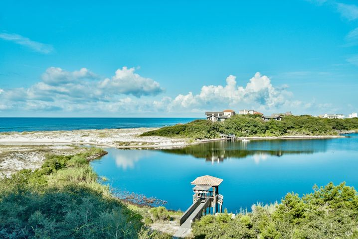 Enjoy stunning, unobstructed western views of the Gulf of Mexico & Redfish Lake from this lovely condominium residence at Sanctuary by the Sea.  This home provides space for full-time living or that coveted second home at the beach.  Located on the third floor, this 4 bedroom 4.5 bath two story home features two waterfront master bedrooms & gracious living space for those important family gatherings.  Features include a large kitchen with Viking appliances, a laundry room, an entry hall, open living and dining area, and a 10' x 38' covered balcony. The second, oversized master bedroom suite is located on the second level with a massive 22' x 38' balcony boasting forever views of the Gulf of Mexico.  Amenities include 24-hour security, 3 pools, private storage, virtual golf, & workout room