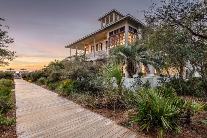 Situated just one home off the Gulf along quiet Boardwalk D in Rosemary Beach, this Southern-style beach cottage offers picturesque Gulf views. Quality construction by Ficarra Builders, the Main House, Carriage House, and courtyard with private pool sit on one of the larger lots in Rosemary Beach. Spacious, covered balconies face the Gulf on both the first and second levels, with an outdoor fireplace on the upstairs porch, and the top floor covered tower offers panoramic Gulf views. With solid Mahogany doors, custom Marvin windows, hand-turned interior and exterior wood, and wrap around balconies make this a timeless Rosemary Beach home.