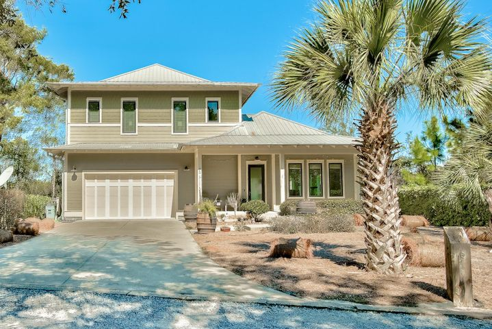 Stunning three story, 4B/4.5B home sits on a private cove with sweeping coastal dune lake views