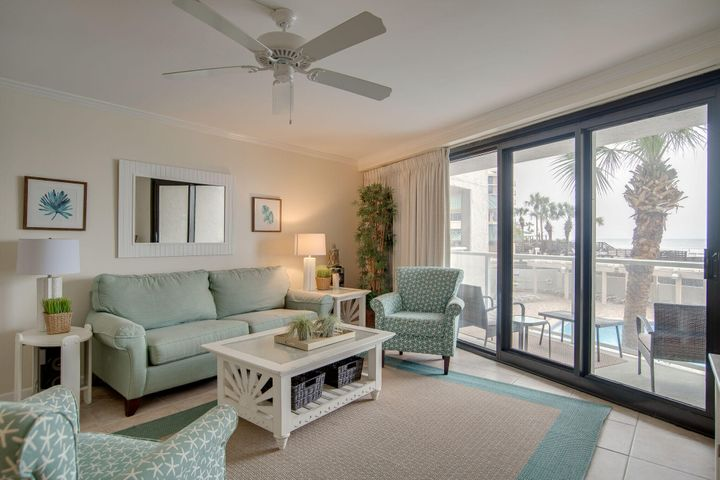 Totally remodeled exquisite unit with bedroom facing the Gulf.  Location is ideal... never use crowded elevators.  Walk from parking lot to the unit and from the unit to the beach and pool. Beautiful views of Gulf and pool from every room. The kitchen has granite counter tops, stainless steel appliances, custom cabinets, and recessed lighting.  Bathroom was redone. Beautifully decorated with new furniture! Unit is sold fully furnished and rental ready. Rental Projections between $35K and 38K. Buyer to verify all dimensions.