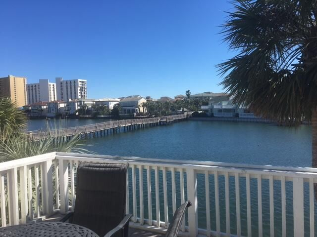 VERY NICE  2BR 2 1/2 BA LAKEFRONT CONDO IN SOUTHBAY BY THE GULF. A WELL ESTABLISHED  CHARMING 109 UNIT COMPLEX IN MIDDLE OF DESTIN ON 14 LANDSCAPED ACRES FROM SOUTHSIDE OF HIWY 98 TO THE GULF OF MEXICO. CONDO COMES FULLY FURNISHED AND CAN DO $30000  IN GROSS RENTALS. KITCHEN HAS RECENTLY BEEN REMODELED WITH UPGRADED  FLOORING, LIGHTING, CABINETS, GRANITE COUNTERS, TILE BACKSPLASH AND S/S APPLIANCES. TWO SPACIOUS DECKS OVERLOOKING DUNES OF DESTIN LAKE ADD 200 SQ FT OF OUTDOOR LIVING SPACE. YOU CAN FISH OFF BOTH DECKS OR ENJOY THE PRISTINE WATER VIEWS.  SHORT WALK TO THE 300' OF PRIVATE WHITE SAND BEACH.  PROPERTY HAS TWO POOLS, ONE HEATED, TWO KIDDIE POOLS, PICNIC AREA, CLUBROOM, TWO LIGHTED TENNIS COURTS AND SHUFFLEBOARD,  A FAMILY ORIENTED PET FRIENDLY  PROPERTY.