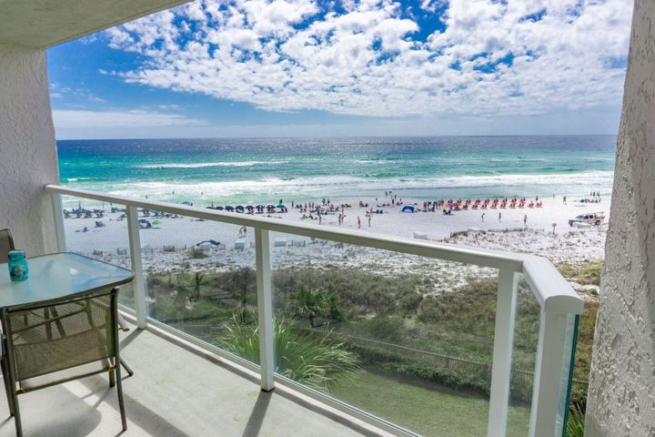 Updated with clean neutral tones that compliment the gulf front views from every room, this unit is the biggest one bedroom floor plan for Beachside II.  From the 5th floor and facing east, you have majestic views, as far as the eye can see, of the turquoise gulf water and sandy white beaches.   Light tan diagonally laid large tile in living area, luxury wood flooring in bedroom, walk in tile shower, granite countertops in bath room and kitchen, stainless steel appliances, light wood farm style furniture, clean white sofa with coordinating chair, pristine white bed linens and light wood colored kitchen cabinetry make this property feel like home with a classic easy style. The large balcony with table and chairs provides the best place to relax with the gulf breezes cooling you off while you listen to the soft waves crashing on the sugar white beach below.  Private deeded beach access, a gulf side pool and all the amenities that Sandestin offers, makes this property a wonderful investment or 2nd home.  Sandestin is home to world class golf courses, a first rate tennis center, miles of nature trails, several community pools, a marina, and Baytowne where there are year round concerts, wonderful seafood restaurants and family eateries, boutigue shopping and kids' entertainment.