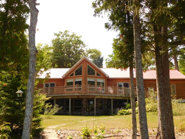 LAKE SUPERIOR WATERFRONT 150' OF BEAUTIFUL LAKE FRONTAGE. 3 BEDROOM 2 BATH CUSTOM BUILT RANCH HOME WITH FULL WALK OUT BASEMENT.