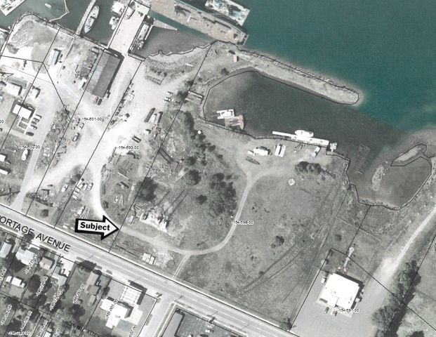 Prime waterfront commercial property on the St. Mary's River. Just over 6.5 acres with protected cove and access to East Portage Avenue.