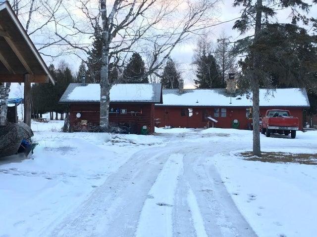 Vintage cottage, deep water, on 1500' WF, 19+ cedar lined acres, 4 miles outside Cedarville.