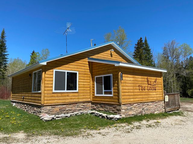 Completely turnkey rental cabin on 16 acres