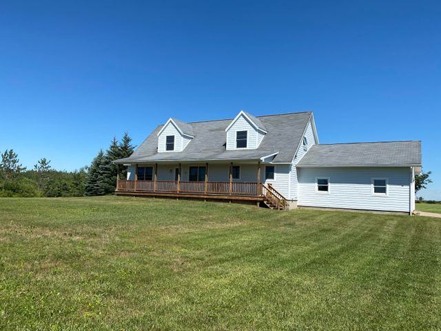 Cap Cod style home with 4 bedrooms, 3 bathrooms, heated detached garage with large doors