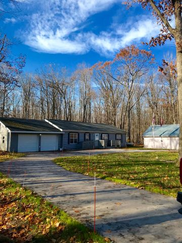 Beautiful Ranch ,out of town but on maintained paved road. Many add-ons to this home.